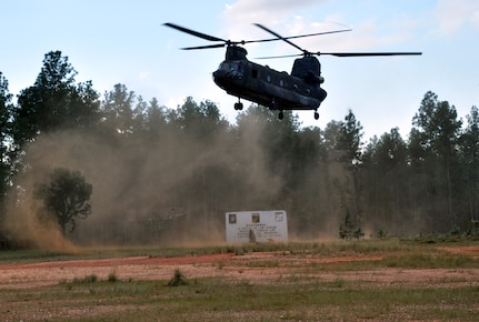 A CH-47 Chinook helicopter assigned to Joint Task Force-Bravo's 1-228th Aviation Regiment departs Mocoron, Honduras, during an operation as part of Joint Task Force-Bravo's Culminating Exercise (CULEX), Dec. 4, 2013.  For the CULEX, more than 90 members of Joint Task Force-Bravo deployed to the Department of Gracias a Dios, Honduras, to conduct both real-world and exercise operations.  (U.S. Air Force photo by Capt. Zach Anderson)