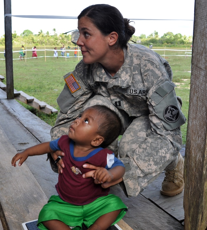 U.S. Army Capt. Diane Klescewski weighs a Honduran infant during a Medical Readiness Training Exercise as part of Joint Task Force-Bravo's Culminating Exercise (CULEX), Dec. 3, 2013.  For the CULEX, more than 90 members of Joint Task Force-Bravo deployed to the Department of Gracias a Dios, Honduras, to conduct both real-world and exercise operations.  (U.S. Air Force photo by Capt. Zach Anderson)