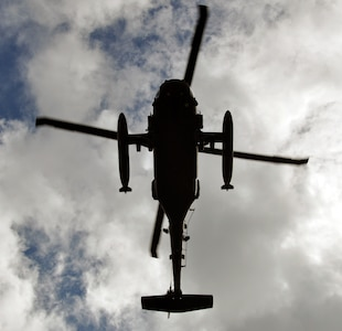A UH-60 Blackhawk helicopter assigned to Joint Task Force-Bravo's 1-228th Aviation Regiment flies overhead during an operation as part of Joint Task Force-Bravo's Culminating Exercise (CULEX), Dec. 3, 2013.  For the CULEX, more than 90 members of Joint Task Force-Bravo deployed to the Department of Gracias a Dios, Honduras, to conduct both real-world and exercise operations.  (U.S. Air Force photo by Capt. Zach Anderson)
