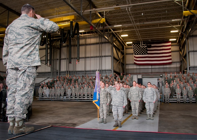 Col. James M. Phillips salutes his wing as the new commander of the 919th Special Operations Wing Dec 7, at Duke Field, Fla.  Phillips served as the 919th Special Operations Group commander before taking command of the wing. (U.S. Air Force photo/Tech. Sgt. Jasmin Taylor)