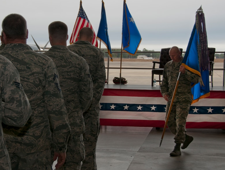 Chief Master Sgt. Tom Mason prepares the formation for the assumption of command ceremony that installed Col. James M. Phillips as commander of the 919th Special Operations Wing Dec.  7, at Duke Field, Fla.   (U.S. Air Force photo/Tech. Sgt. Jasmin Taylor)