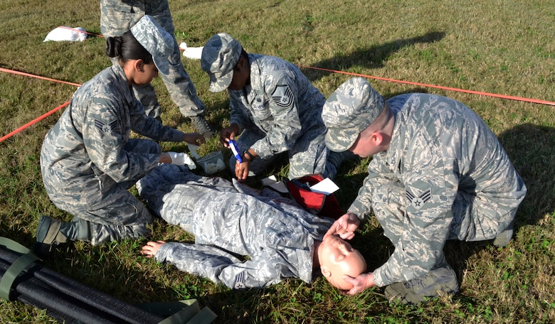 U.S. Air Force Airmen participate in a self aid buddy care exercise as part of Valiant Eagle 2013.