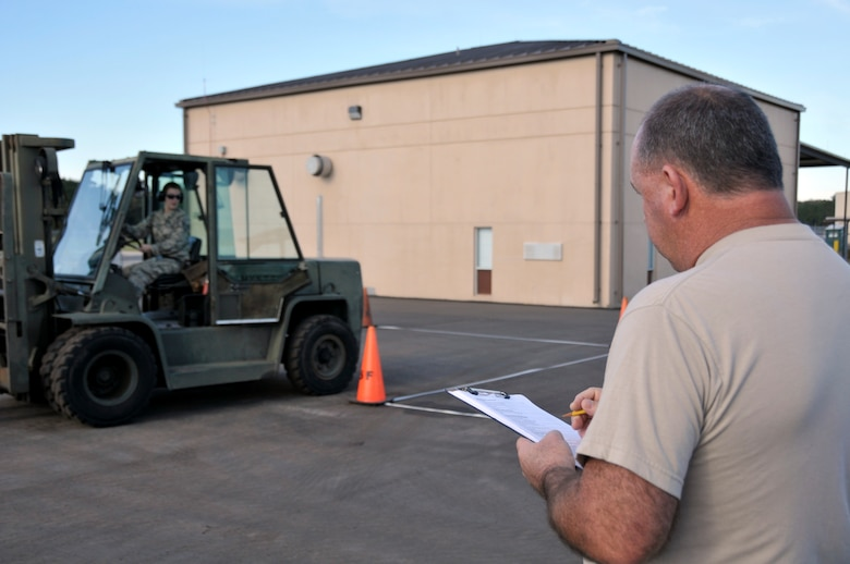 U.S. Air Force Airmen participate in a forklift driving competition as part of Valiant Eagle 2013.