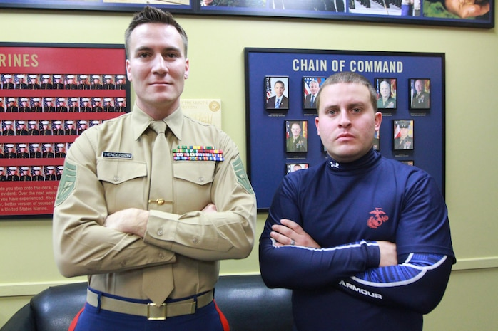 Gunnery Sgt. Joe Henderson, left, and David Flores, right, pose for a photograph inside the Marine recruiting substation Nov. 23.  Flores, a Rhode Island resident, is enrolled in the Marine Corps Delayed Entry Program and is scheduled to ship to recruit training at Marine Corps Recruit Depot Parris Island, S.C., in May.