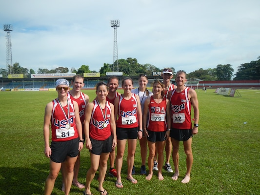 Team USA after their run during the 2013 CISM World Military Marathon Championship in Paramaribo, Suriname on 23 November.  From left to right: CPT Samantha Wood (Army); LTC Liam Collins (Army); CPT Nicole Solana (Army); CDR Matthew Thomas (Navy); Maj Elissa Ballas (USAF); Capt Justine Whipple (USMC); Lt Col Brenda Schrank (USAF); PO2 Justin Thurner (Navy); CDR Conrad Orloff (Navy)