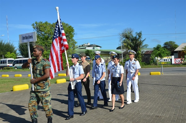 Maj Elissa Ballas carries the flag as Team USA marches in for the opening ceremony of the 2013 CISM World Military Marathon Championship in Paramaribo, Suriname on 19-24 November.
