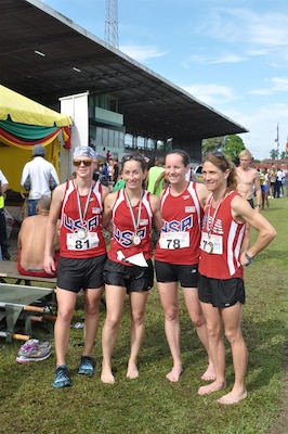 Team USA Women finish 3rd in team competition during the 2013 CISM World Military Marathon Championship in Paramaribo, Suriname on 23 November.  From left to right:  CPT Samantha Wood (Army); CPT Nicole Solana (Army); Maj Elissa Ballas (USAF); Lt Col Brenda Schrank (USAF)