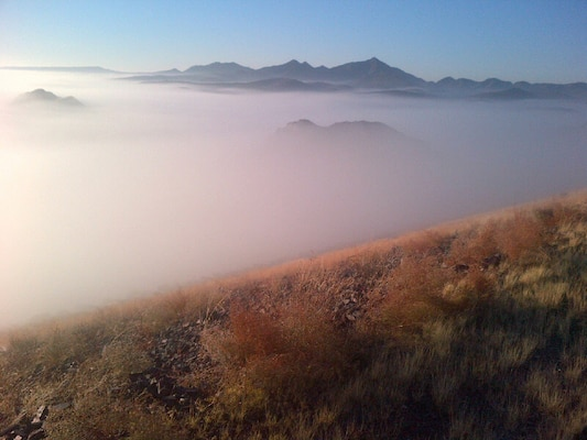 A view into the fog from atop Painted Rock Dam on the Gila River, upstream of Yuma, Ariz.