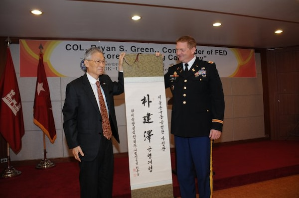 The Republic of Korea -U.S. Alliance Friendship Association presented Col. Bryan S. Green, commander and district engineer, of the U.S. Army Corps of Engineers Far East District, with a Korean name at a ceremony at the Korea Ministry of National Defense club Dec. 3.