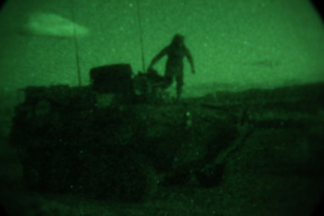 Sergeant Christopher Clifton, light armored vehicle crewman, Delta Company, 1st Light Armored Reconnaissance Battalion, prepares to execute a night maneuver during a weeklong field exercise here, Nov. 18 through 24, 2013. Clifton said night is the best time to attack because people tend to get tired, complacent and let their guard down.