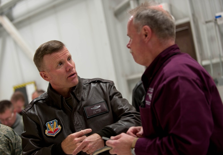 Lt. Gen. Tod D. Wolters, 12th Air Force (Air Forces Southern) commander, talks with Brian James, 28th Maintenance Group Air Force Engineering and Technical Services chief, about his role in accomplishing the base mission during a visit at Ellsworth Air Force Base, S.D., Dec. 4, 2013. Wolters emphasized to all Airmen he met that their efforts are greatly appreciated and recognized by not only Ellsworth leaders, but top Air Force leaders as well. (U.S. Air Force photo by Senior Airman Zachary Hada/Released)