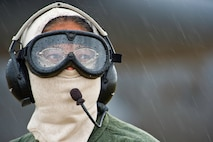 U.S. Air Force Capt. Tracy Tucker, a flight nurse with the 433rd Aeromedical Evacuation Squadron, Joint Base San Antonio-Lackland, Texas, works in the rain as a safety spotter during Warrior Exercise 86-13-01 (WAREX)/Exercise Global Medic, 2013, at Fort McCoy, Wis. July 27, 2013. The WAREX provides units an opportunity to rehearse military maneuvers and tactics. Held in conjunction with WAREX, Global Medic is an annual joint-field training exercise designed to replicate all aspects of theater combat medical support. (U.S. Air Force photo/Tech. Sgt. Efren Lopez)