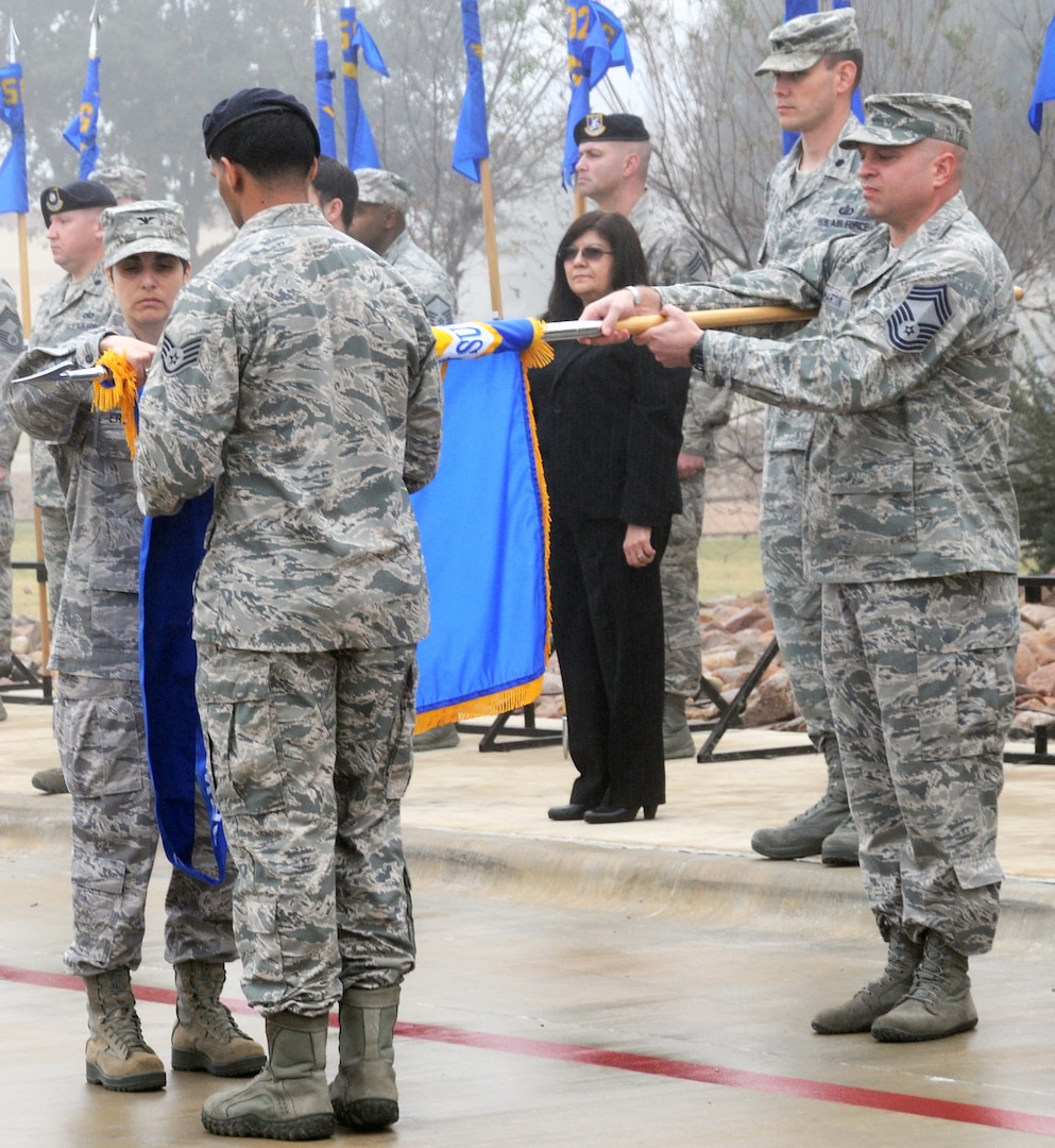 Col. Christine Erlewine cases the 902nd Mission Support Group colors for inactivation during the 502nd Air Base Wing transformation ceremony at Joint Base San Antonio-Fort Sam Houston Dec. 4. The 902nd MSG, which Erlewhine was the commander of, was redesignated as the 502nd Security Forces and Logistics Support Group at JBSA-Randolph. (U.S. Air Force photo by Steve Elliott)