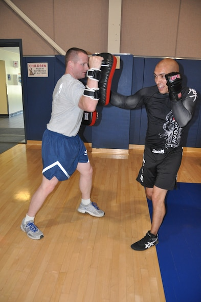 Senior Airman David Adolfo (right) and Senior Airman Corey Quirke, 452nd Civil Engineer Squadron members, spar at the March Air Reserve Base gym to keep fit and agile. Adolfo, who has been participating in Mixed Martial Arts since he was a young boy, learns and teaches vaious martial arts disciplines while incorporating the warrior ethos into all areas of his life in and out of the ring.
