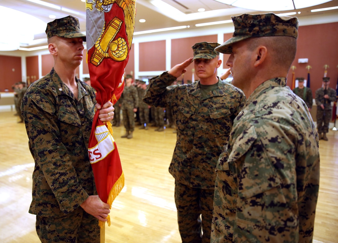 Lieutenant Col. Joel F. Schmidt receives the unit's colors from Lt. Col. Steven M. Wolf, as Schmidt assumes control of 2nd Battalion, 2nd Marine Regiment, 2nd Marine Division aboard Marine Corps Base Camp Lejeune, Dec. 10, 2013. Wolf is departing 2nd Bn., 2nd Marines and will attend the College of Naval Warfare in Newport, R.I., and Schmidt is coming from Marine Corps Forces Special Operations Command.