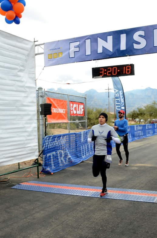 Senior Airman Savas Rivera, a regional weather forecaster/special support forecaster assigned to the 612th Support Squadron, cross the finish line Holualoa Tucson Marathon in Oracle, Ariz., Oct. 8, 2013.  Rivera finished third in his age group.  (U.S. Air Force photo by Staff Sgt. Heather R. Redman/Released)