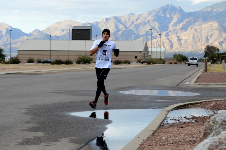 Senior Airman Savas Rivera, a regional weather forecaster/special support forecaster assigned to the 612th Support Squadron, runs around Davis-Monthan AFB, Ariz., as part of his marathon training, Dec. 5, 2013.  Rivera trained for the Holualoa Tucson Marathon and set a new personal record on Oct. 8.  (U.S. Air Force photo by Staff Sgt. Heather R. Redman/Released)