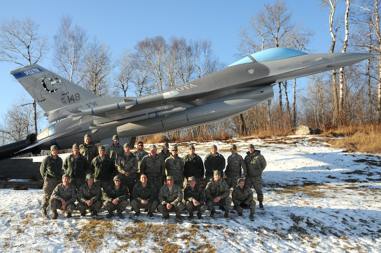 U.S. Air Force F-16 Crew Chiefs, 148th Fighter Wing, Duluth, Minn. pose for a group photo on Dec. 4, 2011.  The crew chiefs have been helping to raise money annually since 2010 in hopes of giving some local children a better Christmas.  (U.S. Air National Guard photo by Tech. Sgt. Brett R. Ewald/Released)