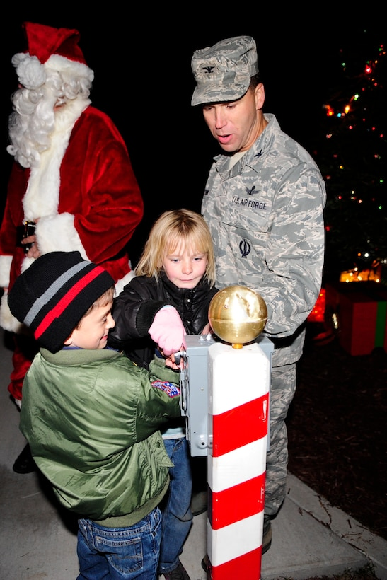 VANDENBERG AIR FORCE BASE, Calif. – Col. Brent McArthur, 30th Space Wing vice commander, and two children from the Vandenberg Girl and Boy Scouts prepare to light the tree during Vandenberg's annual Tree Lighting Ceremony here Dec. 9, 2013. The event included caroling, hot chocolate, the lighting of the tree and a visit from Santa Claus.  (U.S. Air Force photo/ Airman 1st Class Yvonne Morales)
