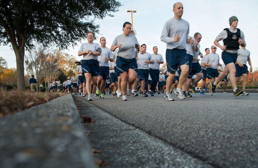 Members of Joint Base Charleston take part in the Commander's Challenge 5K Run Dec. 6, 2013, at Joint Base Charleston – Air Base, S.C. The Commander's Challenge is held monthly to test Team Charleston's fitness abilities. (U.S. Air Force photo/ Senior Airman Ashlee Galloway)