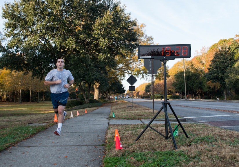2nd Lt. Phil Ramsey, 628th Civil Engineer Squadron programmer, runs toward the finish line during the Commander's Challenge 5K Run Dec. 6, 2013, at Joint Base Charleston – Air Base, S.C. The Commander's Challenge is held monthly to test Team Charleston's fitness abilities. Ramsey was the top male runner with a time of 19:28. (U.S. Air Force photo/ Senior Airman Ashlee Galloway)