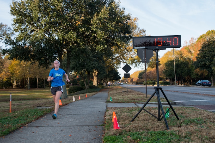 Jessica Ramsey, spouse of 2nd Lt. Phil Ramsey, 628th Civil Engineer Squadron programmer, runs toward the finish line during the Commander's Challenge 5K Run Dec. 6, 2013, at Joint Base Charleston – Air Base, S.C. The Commander's Challenge is held monthly to test Team Charleston's fitness abilities. Ramsey was the top female runner with a time of 19:40. (U.S. Air Force photo/ Senior Airman Ashlee Galloway)