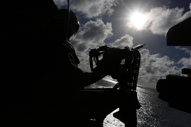 Petty Officer 2nd Class Jeremy A. Cieplich, posts on a GAU-21/A .50 caliber machine gun mounted in a MH-60S Seahawk helicopter, before executing live-fire, close-air support training Dec. 10 at Farallon de Medinilla Target Range, Northern Mariana Islands. The MH-60s are currently forward deployed to the island of Tinian, coordinating with Marine Corps during Exercise Forager Fury II. FF II is an aviation training relocation event intended to meet U.S.-Japan bilateral goals such as reduced local impacts by dispersing the training to other areas and increased operational readiness. Cieplich is a naval aircrewman with Helicopter Sea Attack Squadron 25 based out of Andersen Air Force Base, Guam.