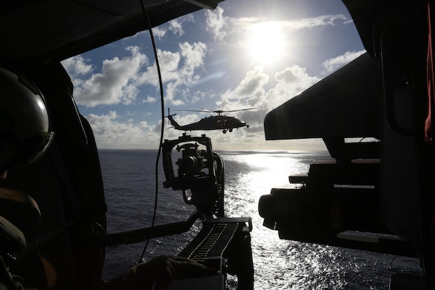 A MH-60S Seahawk helicopter flies in an attack formation before firing on simulated target Dec. 10 at Farallon de Medinilla Target Range, Northern Mariana Islands. The MH-60s are currently forward deployed to the island of Tinian, coordinating with Marine Corps units during Exercise Forager Fury II. FF II will allow MAG-12 to improve aviation combat readiness and will simulate operations in a deployed, expeditionary environment. The Helicopters are with Helicopter Sea Attack Squadron 25 based out of Andersen Air Force Base, Guam.