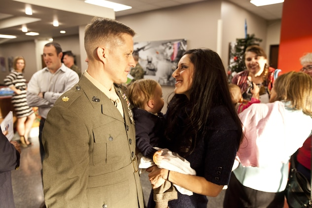 Maj. Robb McDonald, air officer with 1st Marine Special Operations Battalion, from Yuma, Ariz., stands with his wife and son before receiving the Silver Star for his efforts against an enemy attack aboard Camp Bastion, Afghanistan in 2012. Lt. Gen. John A. Toolan, commanding general of I Marine Expeditionary Force, pinned the nation's third highest award on McDonald aboard Camp Pendleton, Calif., Dec. 9.