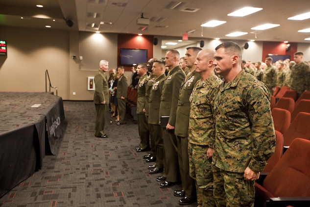 Lt. Gen. John A. Toolan, commanding general of I Marine Expeditionary Force, stands for the national anthem before awarding the Silver Star to Maj. Robb McDonald, air officer with the 1st Marine Special Operations Battalion, from, Yuma, Ariz., aboard Camp Pendleton, Calif., Dec. 9. McDonald received his award for his efforts against an enemy attack aboard Camp Bastion, Afghanistan in 2012.