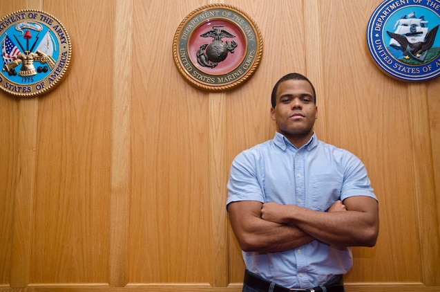 Jorge Estevez, stands inside Cpl. Jennifer M. Parcell Ceremony Room at the Military Entrance Processing Station aboard Fort George G. Meade, Md., Dec. 2, 2013. Estevez, a native of the Dominican Republic, lost 140 pounds in order to join the Marine Corps. He is currently attending recruit training at Marine Corps Recruit Depot Parris Island, S.C. (U.S. Marine Corps photo by Cpl. Bryan Nygaard/Released)