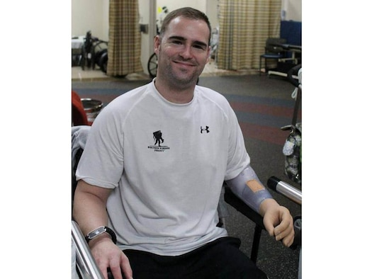 Master Sgt. Joseph Deslauriers smiles with his new prosthetic arm. Deslauries was wounded by an improvised explosive device Sept. 27, 2011, while on patrol in Afghanistan. He is the Air Force Special Operations Command explosive ordnance device program manager. (Photo courtesy of Building Homes for Heroes)