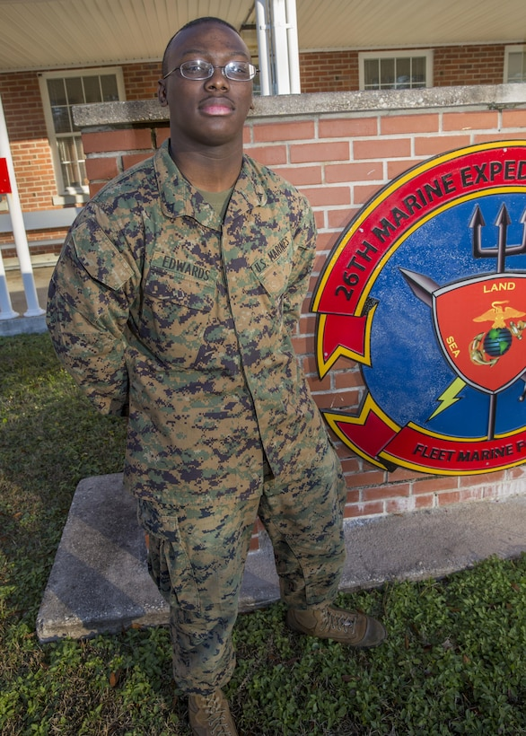 Lance Cpl. Tayevion Edwards, a forward observer with the 26th Marine Expeditionary Unit (MEU), and Cleveland native, poses for a photo outside the MEU's command post aboard Marine Corps Base Camp Lejeune, N.C., Dec. 11, 2013. Edwards embarked with the 26th MEU during its deployment in the Fifth and Sixth Fleet areas of operation. (U.S. Marine Corps Photo by Lance Cpl. Joshua W. Brown/Released)