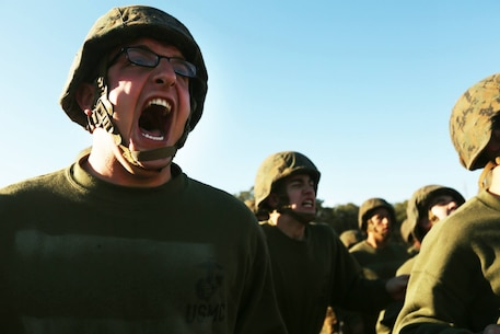 Rct. Jeremy Moore, Platoon 2010, Echo Company, 2nd Recruit Training Battalion, responds to orders from a Marine Corps martial arts instructor during a martial arts training session Nov. 14, 2013.
