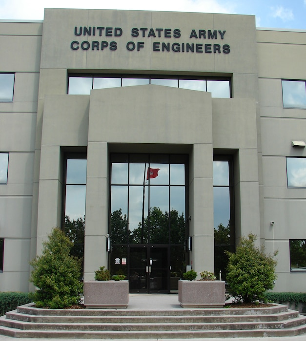 """The main entrance at the U.S. Army Engineering and Support Center building on University Square in Huntsville, Ala. In 1995, the Corps redesignated Huntsville Division, calling it the """"U.S. Army Engineering and Support Center."""" That same year, Huntsville Center moved into its new office on University Square"""