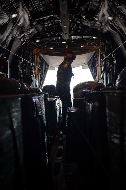 Airman 1st Class Nicholas Brown, 36th Airlift Squadron loadmaster from Yokota Air Base, Japan, makes his way to the back of a C-130 Hercules to shut the rapid doors on Andersen Air Force Base, Guam, before an Operation Christmas Drop mission Dec. 11, 2013. This year marks the 62nd year of Operation Christmas Drop, which began in 1952, making it the world's longest running airdrop mission. (U.S. Air Force photo by Senior Airman Marianique Santos/Released)