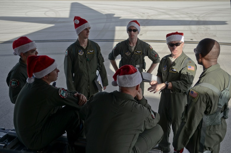 Maj. John Chrampanis, 36th Airlift Squadron C-130 Hercules aircraft commander from Yokota Air Base, Japan, explains the course of the flight to his crew on Andersen Air Force Base, Guam, before an Operation Christmas Drop flight Dec. 11, 2013. Every December, C-130 Hercules aircrews from the 374th Airlift Wing at Yokota AB partner with the 36th Wing at Andersen AFB to airlift food, supplies and toys to islanders throughout Micronesia. (U.S. Air Force photo by Senior Airman Marianique Santos/Released)