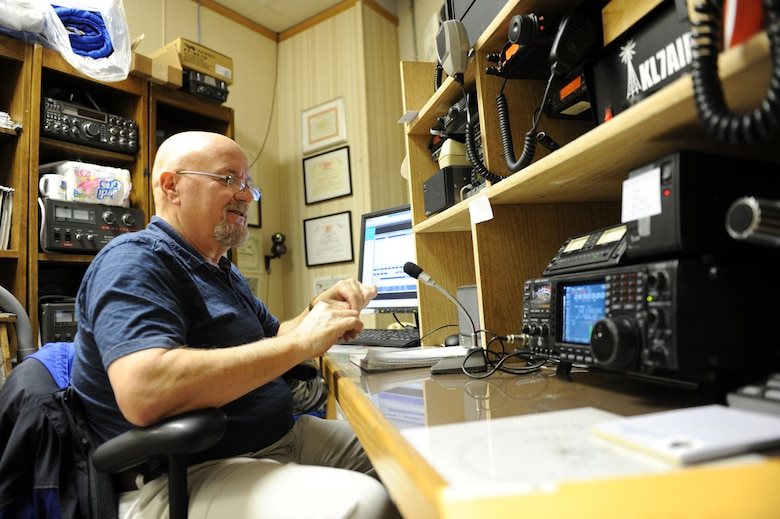 Ron Keech, secretary of the Elmendorf Amatuer Radio Society uses a ham radio in the Elmendorf Amateur Radio Society CIvil Air Patrol building Dec. 9, to speak with other operators. Keech is a Navy military auxilary radio systems operator. (U.S. Air Force Photo/Airman 1st Class Omari Bernard)