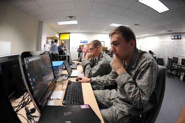 Members of the Academy Cyber Competition team run through scenarios in preparation for an upcoming competition Dec. 10. (U.S. Air Force Photo/John Van Winkle)