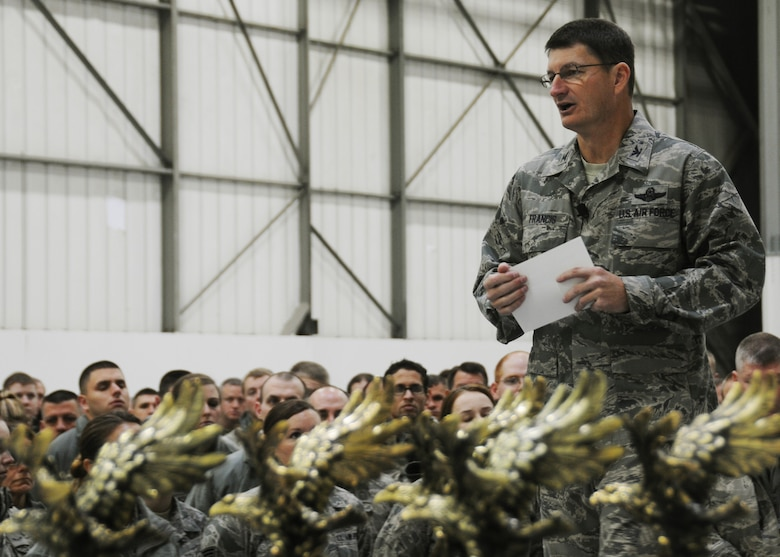 Col. Michael Francis, 131st Bomb Wing commander, Missouri Air National Guard, addresses the wing at the 2013 year-end all call Dec 8, at Whiteman Air Force Base, Mo. Francis discussed the achievements of the past year and outlined his vision for the next. (U.S. Air National Guard photo by Airman 1st Class Nathan Dampf/RELEASED)