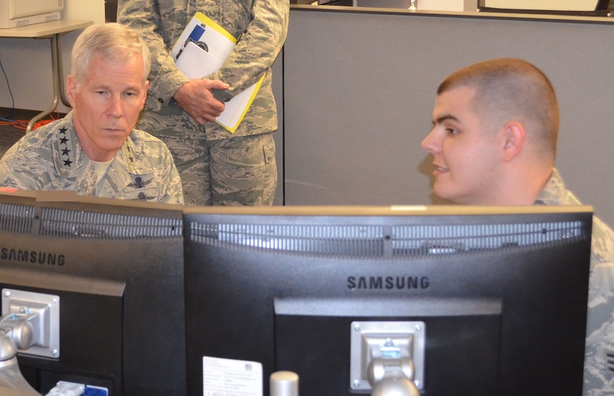 Senior Airman Matthew Welch (right), a cyber operations controller with the 68th Network Warfare Squadron, demonstrated methods to detect breaches of personally identifiable information on Air Force networks to Gen. William L. Shelton (left), commander of Air Force Space Command, during a visit to the 67th Cyberspace Wing at Joint Base San Antonio - Lackland Dec. 4, 2013.  Information obtained due to PII breaches could be used by malicious actors for identity theft or other nefarious activity. (U.S. Air Force photo)