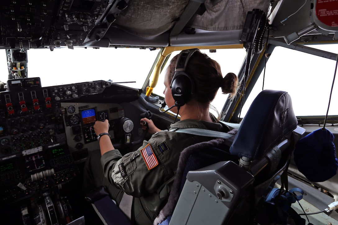 Capt. Heather Combee, 108th Wing pilot, New Jersey Air National Guard, intently flies a KC-135 Stratoranker during an air refueling mission of a C-17 Globemaster III Dec. 5, 2013. The aircrew consisted of pilots, Capts. Johann Hintz, Joel Webley and Combee, as well as boom operators, Tech. Sgts. Jennifer Bowen and Patrick Ogle. The mission provided an opportunity for the the pilots and boom operators to hone their air-refueling skills aboard the KC-135 Stratotanker. (U.S. Air National Guard photo by Tech. Sgt. Armando Vasquez / Released)