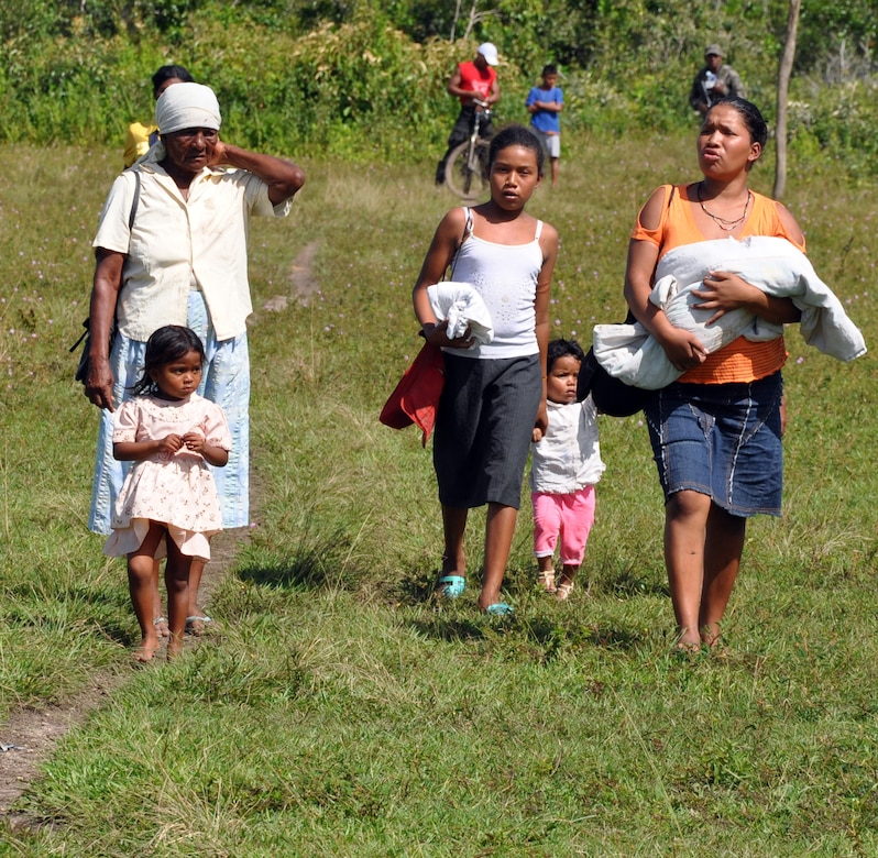 A group of Honduran citizens make their way along a path to receive medical care at a Medical Readiness Training Exercise (MEDRETE) conducted by Joint Task Force-Bravo in the Department of Gracias a Dios, Honduras, Dec. 4, 2013.  Joint Task Force-Bravo routinely partners with the Honduran Ministry of Health and the Honduran military to perform these humanitarian aid missions to provide medical care to the most isolated regions of the country. (U.S. Air Force photo by Capt. Zach Anderson)