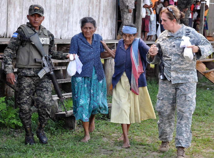 U.S. Army Capt. Vicki English assists an elderly Honduran woman during a Medical Readiness Training Exercise (MEDRETE) conducted by Joint Task Force-Bravo in the Department of Gracias a Dios, Honduras, Dec. 4, 2013.  Joint Task Force-Bravo routinely partners with the Honduran Ministry of Health and the Honduran military to perform these humanitarian aid missions to provide medical care to the most isolated regions of the country. (U.S. Air Force photo by Capt. Zach Anderson)
