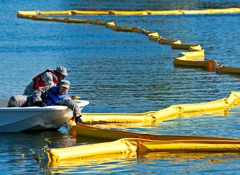 Volunteers position a 500 feet stretch of oil boom to be installed in Weekly Bayou on Eglin Air Force Base, Fla., in a recent waterways oil spill exercise. Boom is an oil containment device used to trap oil in the water so it can be collected before reaching the shore. A collection of emergency responders from more than 15 Eglin units will deploy to Weekly Bayou, Dec. 13, to participate in an oil spill response exercise. The annual exercise is required by federal and state regulations governing Inland Coastal Oil Spill Response for the Eglin AFB Marine Fuel Transfer Facility.  This year's exercise will take place in the Weekly Bayou from 7:30 a.m. until noon.  The Post'l Point Boat Launch Ramp will be closed to the public during these hours, however the Eglin Yacht Club boat launch ramp will be open to boaters during this time due to emergency response vehicles operating in that area. (U.S. Air Force photo/Samuel King Jr.)