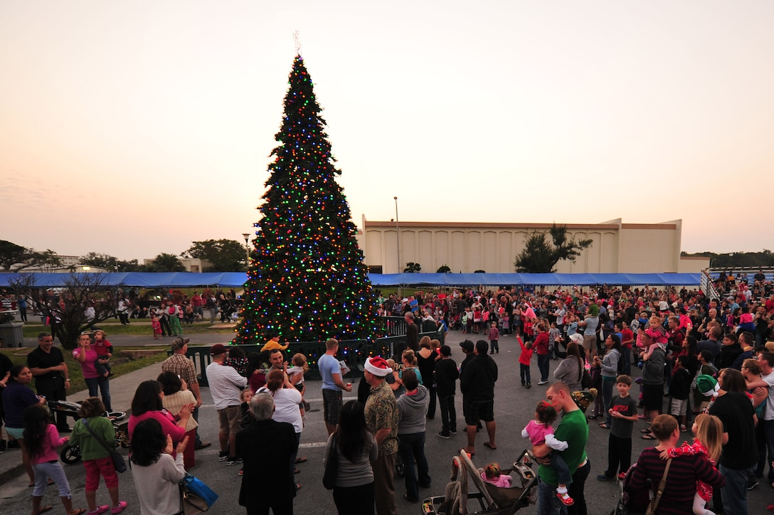 Families gather around Team Kadena's Christmas tree for the tree lighting ceremony on Kadena Air Base, Japan, Dec. 7, 2013. The tree lighting event was the last event of the annual Tinsel Town event for service members and their families. (U.S. Air Force photo by Staff Sgt. Rachelle Coleman)