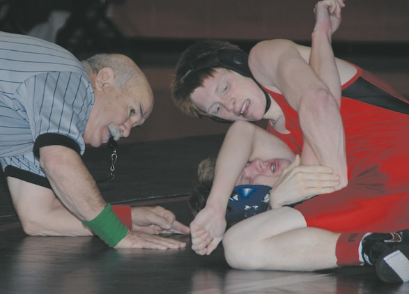 Wrestlers from Lee County, Tift, Thomas County Central and Colquitt high schools as well as youth wrestlers participate in a wrestling quad event held at Thomason Gym aboard Marine Corps Logistics Base Albany Dec. 10.