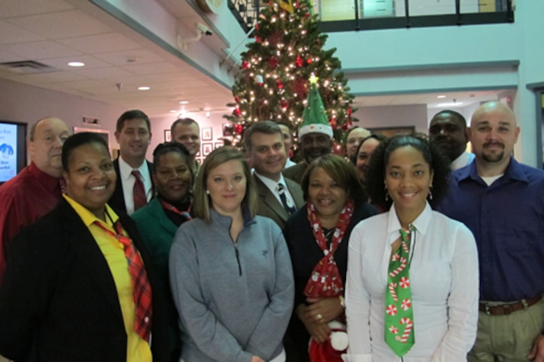 "Members of Huntsville Center's Installation Support and Programs Management Directorate's Facilities Division wear festive clothing Dec. 10 at Huntsville Center. The team is celebrating ""The 12 Days of Christmas"" at the center Dec. 9-20 to reduce stress in the workplace this holiday season."