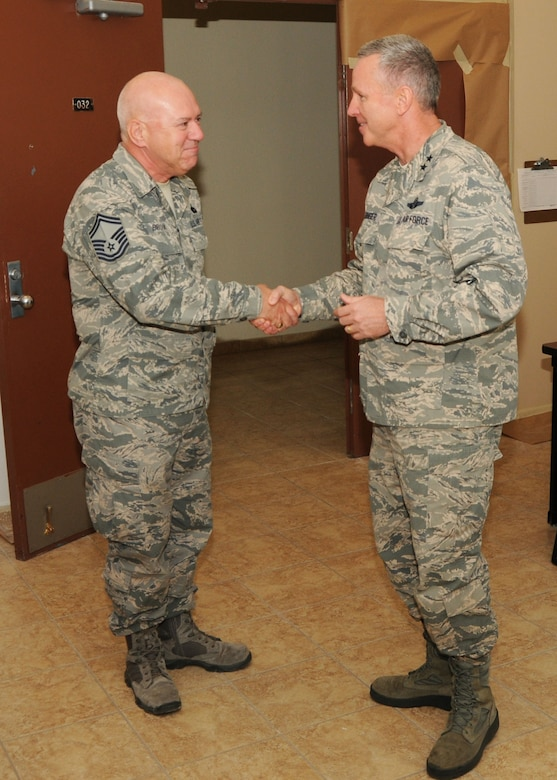 Maj. Gen. William Binger, 10th Air Force Commander, shakes hands and gives a coin to Senior Master Sgt. Stephen Brook, 944th Logistics Readiness Squadron Superintendent of Vehicle Operations, Dec. 10 at Luke Air Force Base, Ariz. (U.S. Air Force photo taken by Tech. Sgt. Louis Vega Jr.)