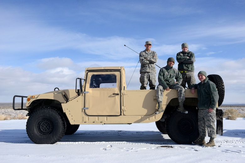 Vehicle operators from the 366th Logistic Readiness Squadron pose for a photo during the Convoy Operations Readiness Training, Dec. 6, 2013, near Mountain Home Air Force Base, Idaho. The purpose of the training was to teach Airmen the skills needed for a combat convoy operation. (U.S. Air Force photo/Senior Airman Caitlin Guinazu/Released)